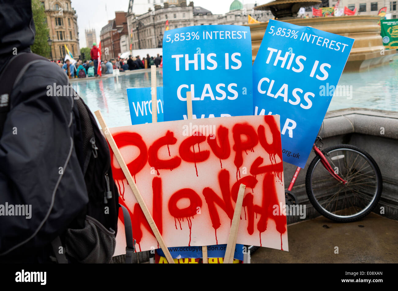 Class War placards in Trafalgar Square during the London May Day rally 2014. - Stock Image