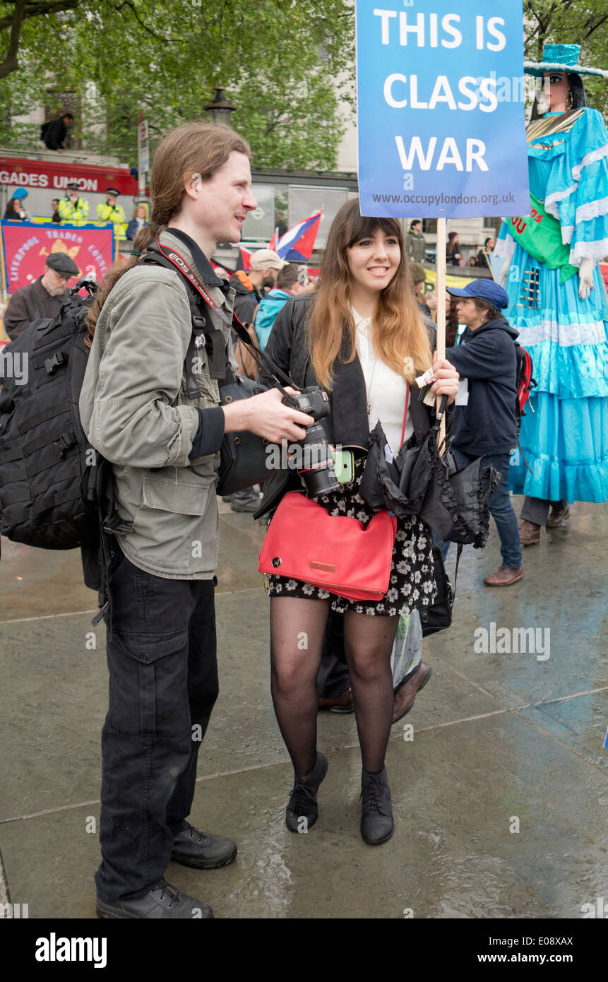 A Class War protester and a photographer at the London May Day rally, 2014. - Stock Image