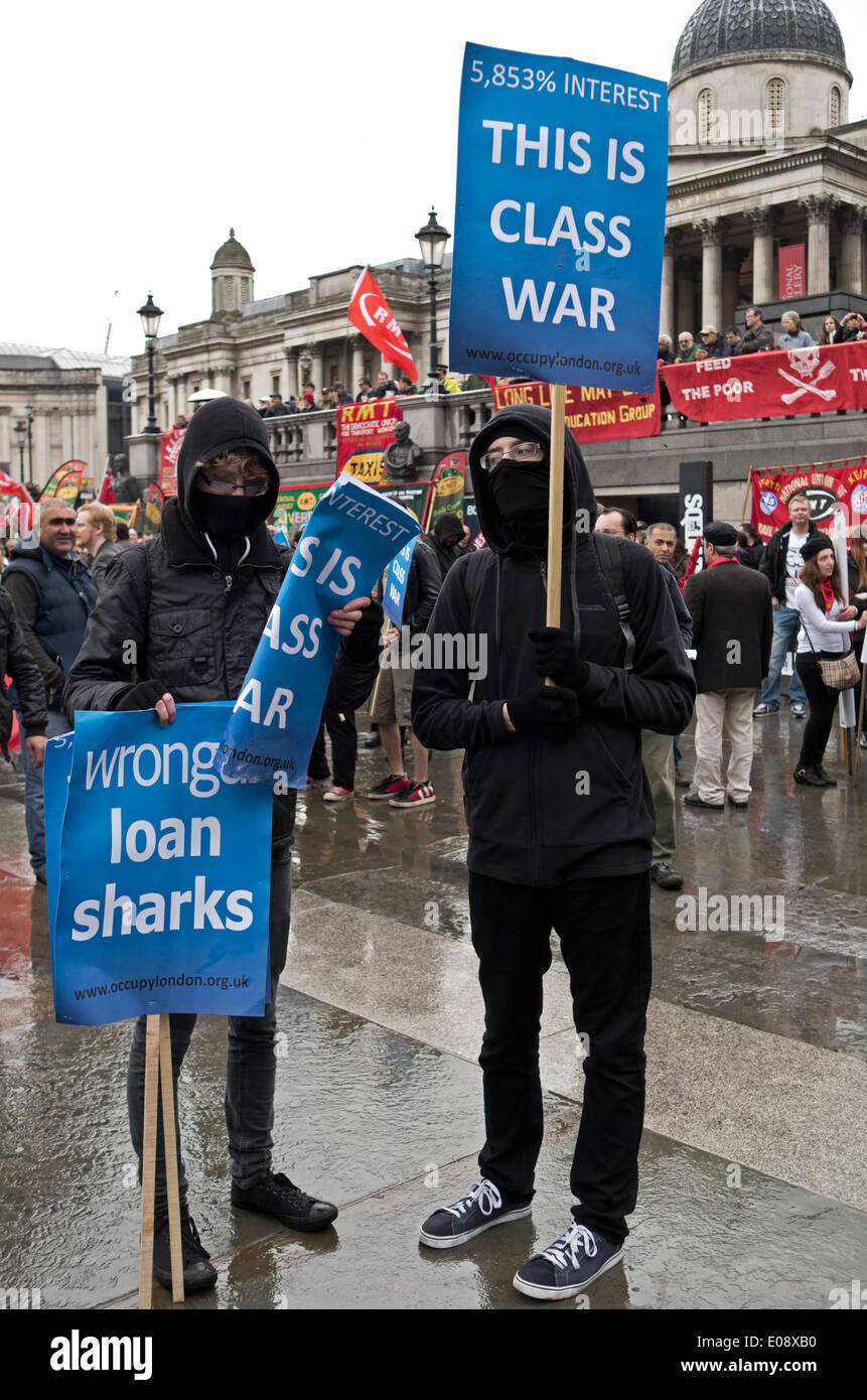 Class War activists protest against Wonga during the London May Day rally, 2014. - Stock Image