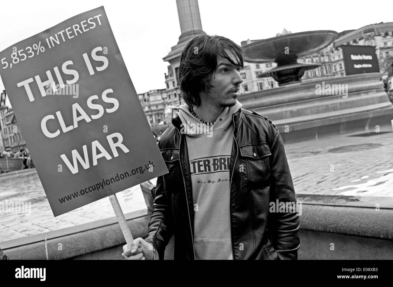 A Class War protester in Trafalgar Square for the London May Day rally 2014. - Stock Image