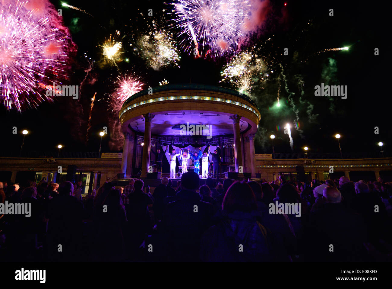 Abba tribute concert with fireworks. Eastbourne bandstand, East Sussex, England, UK - Stock Image