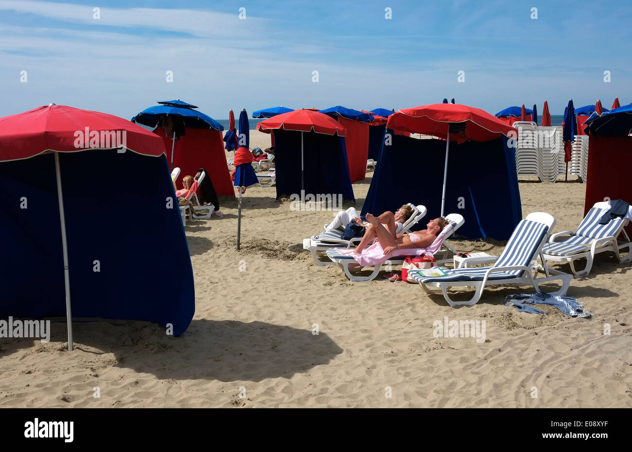 sunbathers on beach, deauville, normandy, france - Stock Image