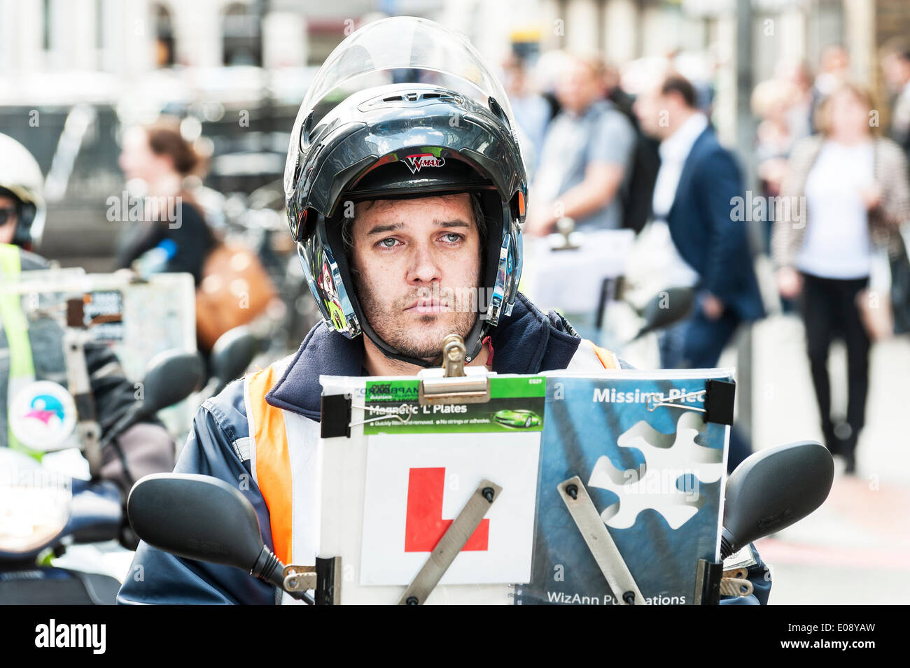 London, UK. 6th May 2014, A very fed up trainee taxi driver participating in the protest over the refusal to place a Black Cab taxi rank outside the entrance to The Shard. Photographer:  Gordon Scammell/Alamy Live News - Stock Image