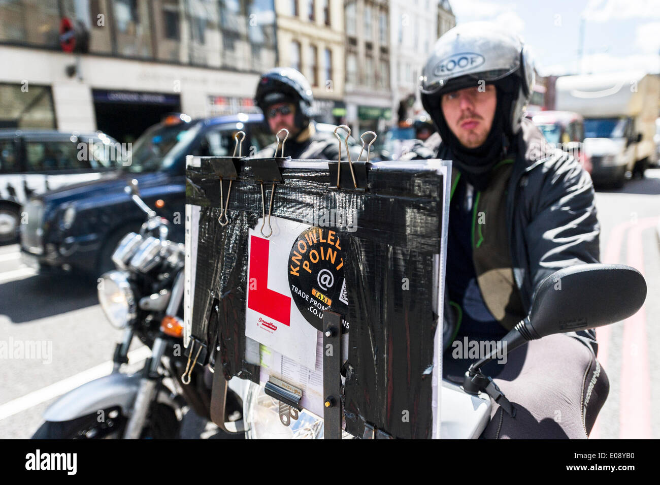 6th May 2014, Trainee Taxi Drivers participate in the demonstration on the streets around The Shard.  Photographer:  Gordon Scammell/Alamy Live News - Stock Image
