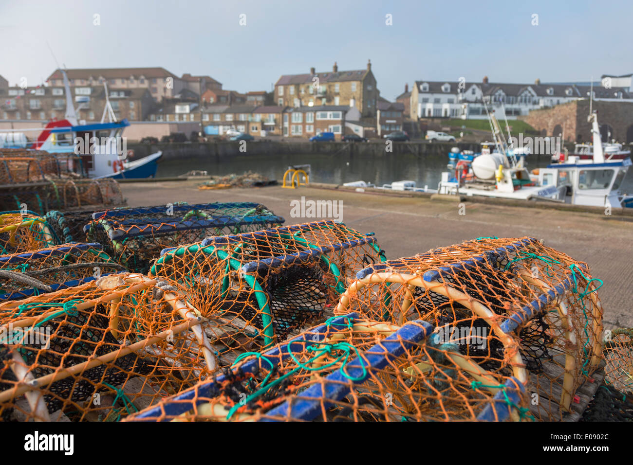 Lobster pots, Seahouses harbour, Northumberland, UK, April 2014 - Stock Image