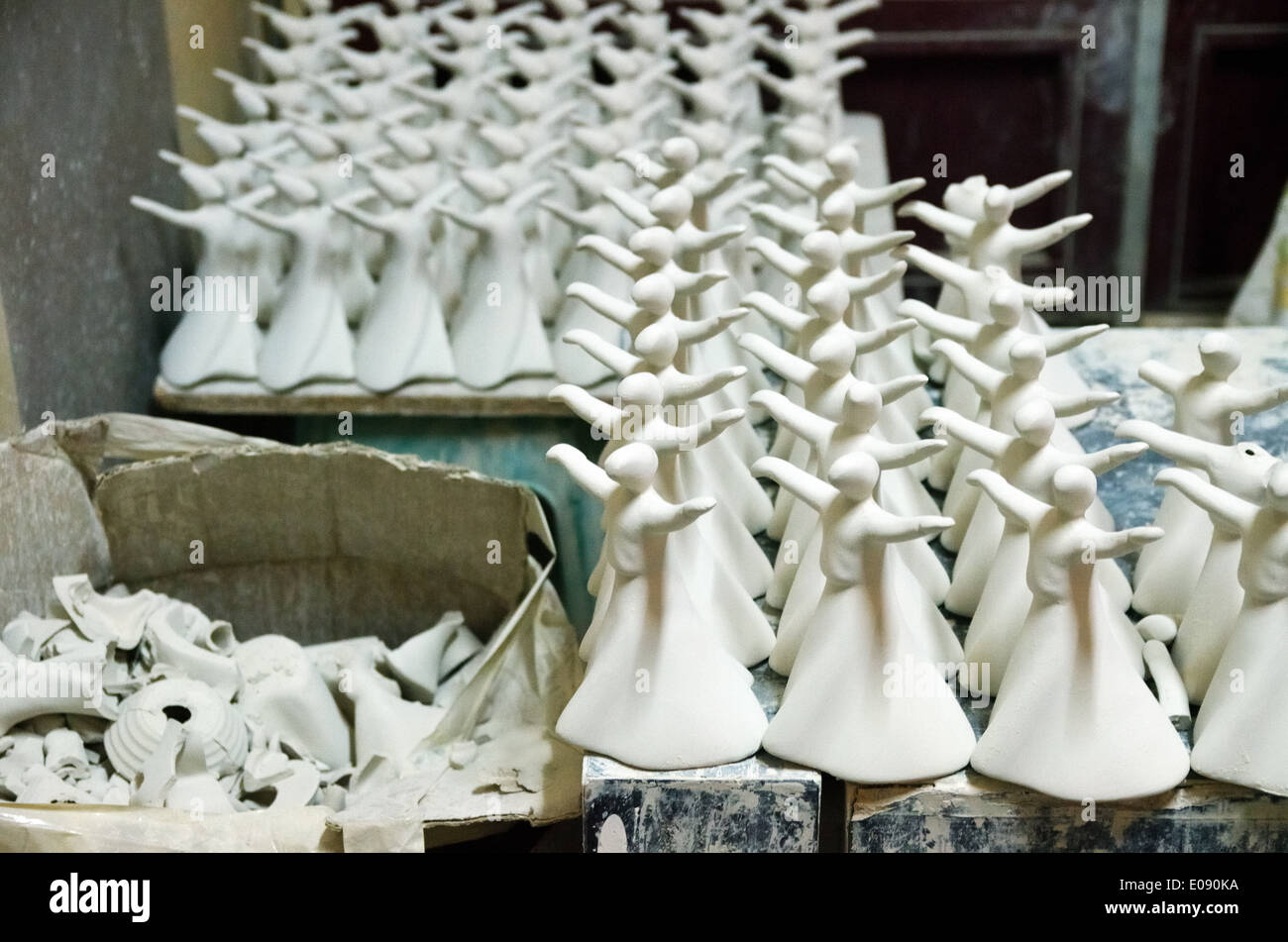 Porcelain souvenir dervishes before roasting. Family pottery workshop in Konya, Turkey - Stock Image