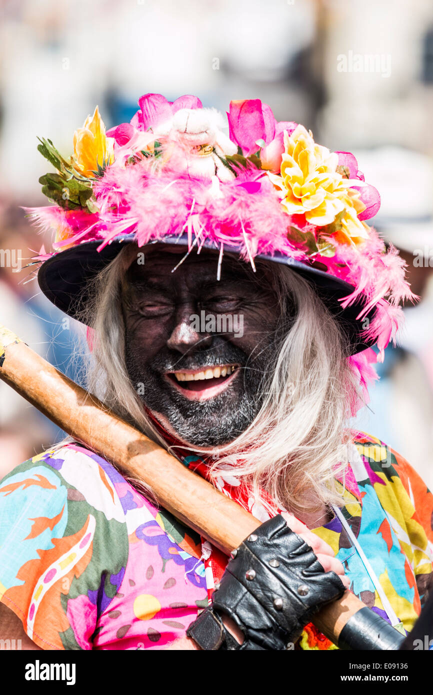 Man Dressed as Black Faced Woman Playing the Fool at the Annual Sweeps Festival Rochester 2014 - Stock Image