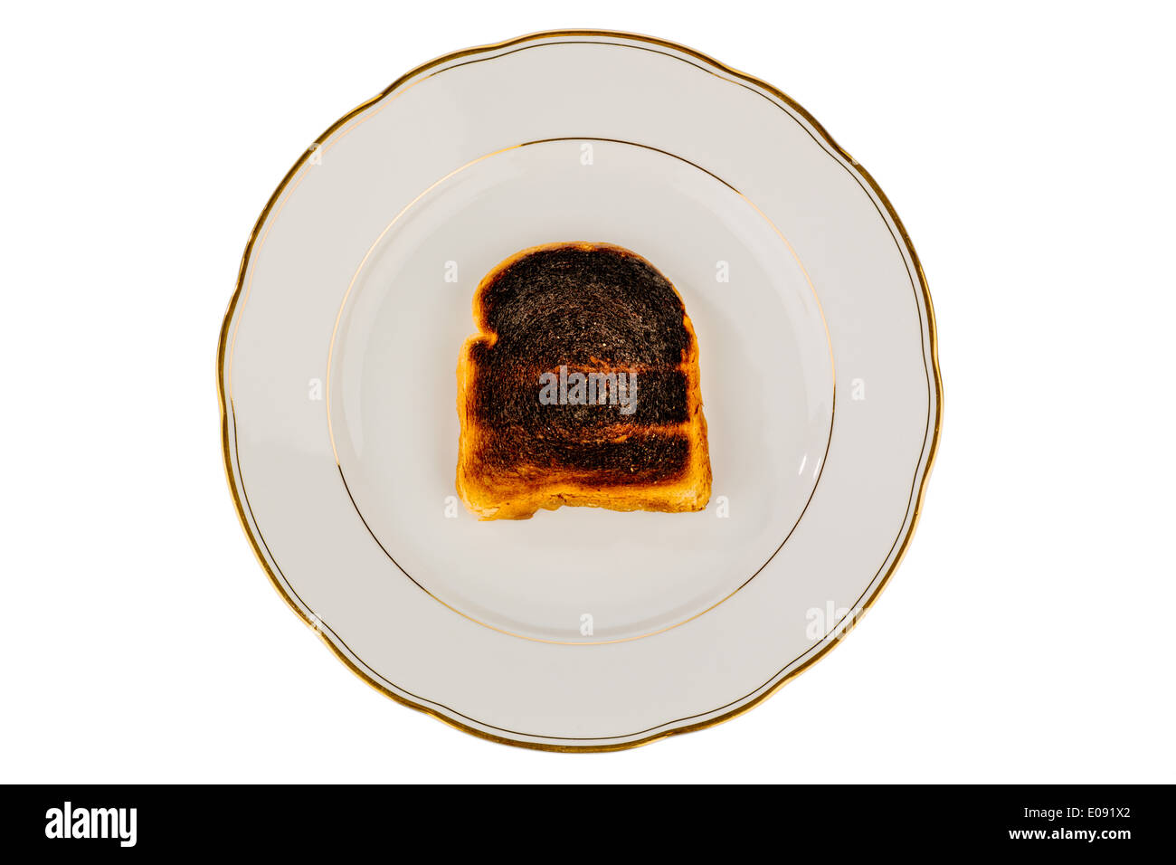 Toast bread became with drink a toast burntly. Burntly toast discs with the breakfast., Toastbrot wurde beim toasten verbrannt. - Stock Image