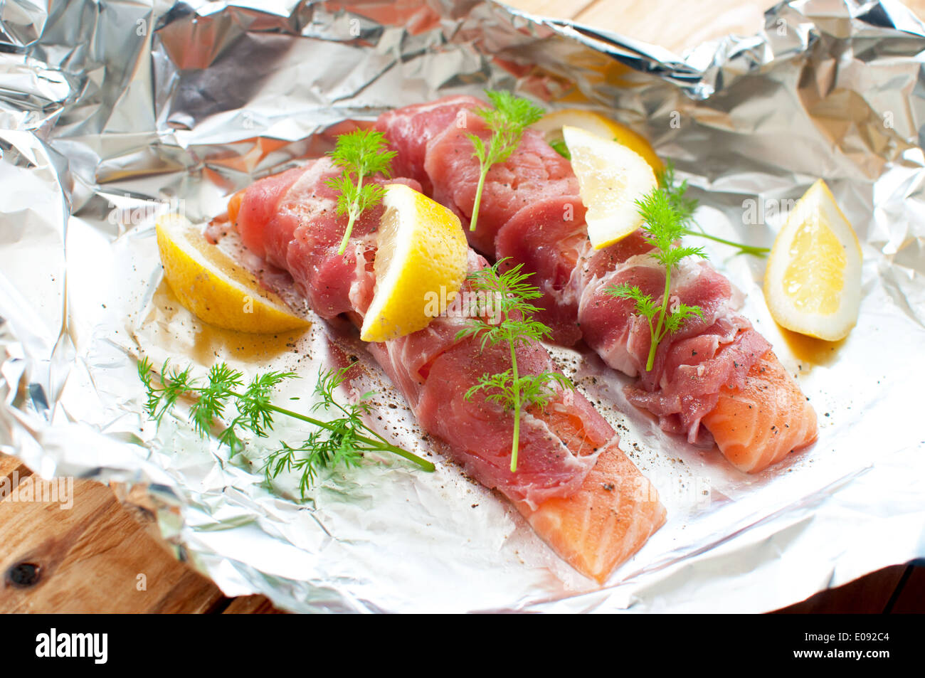 Fresh salmon fillets wrapped with bacon - Stock Image