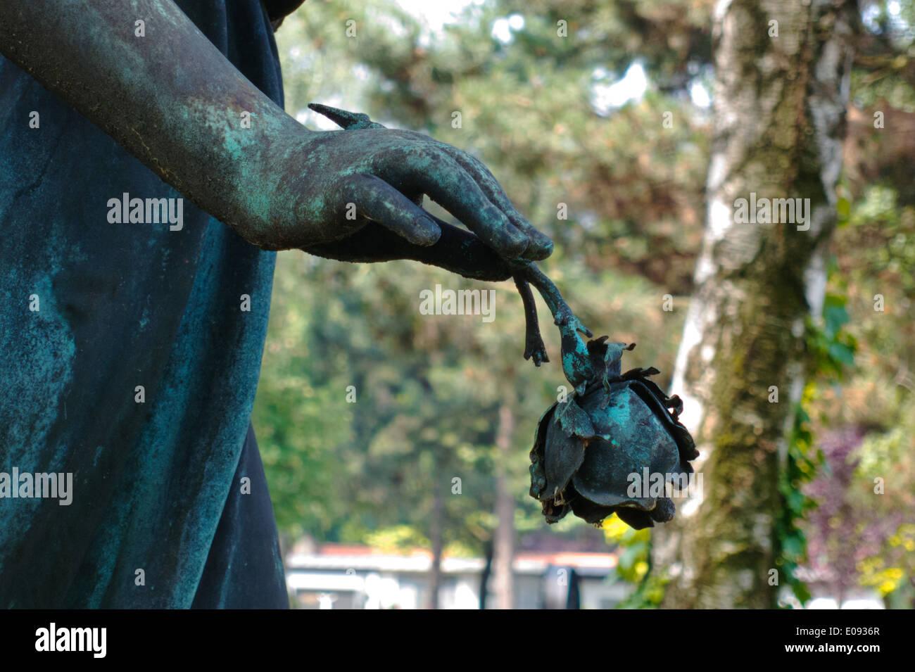 Sculpture with a rose in the hand, Skulptur mit einer Rose in der Hand Stock Photo