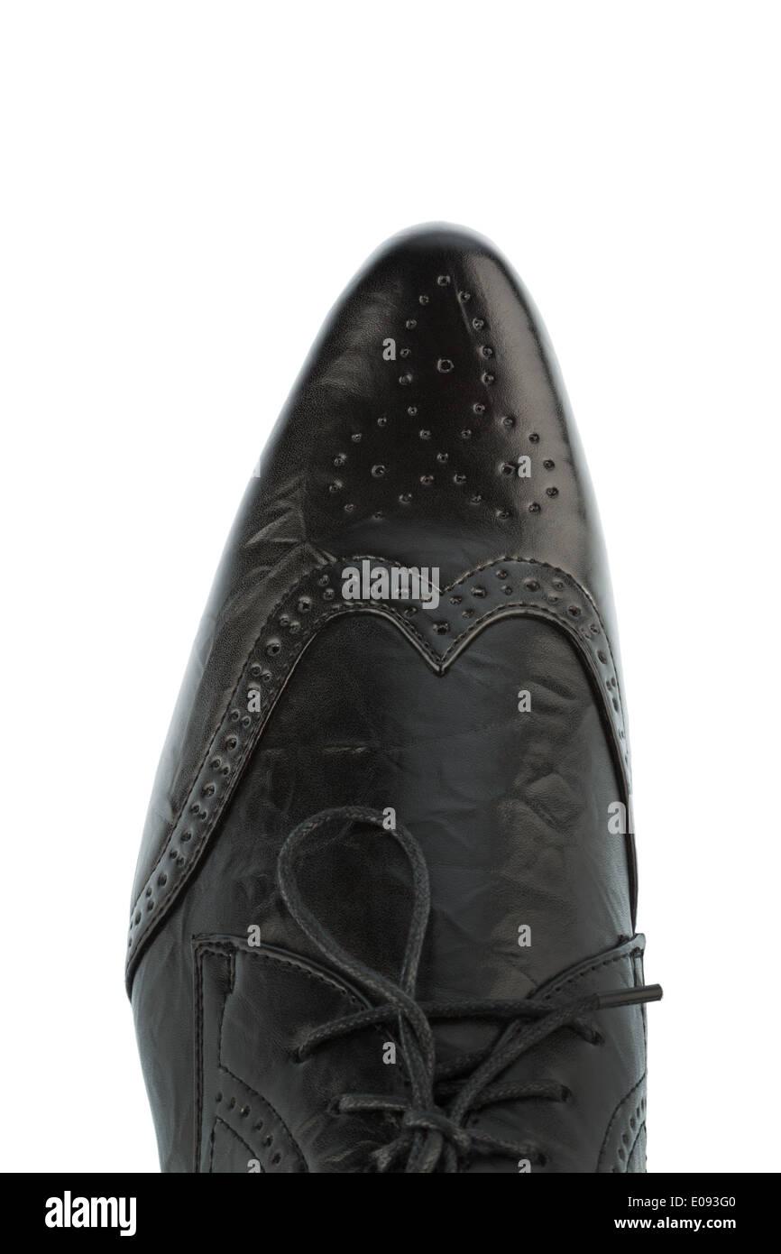Black man's shoe before white background, Schwarzer Herrenschuh vor weissem Hintergrund - Stock Image