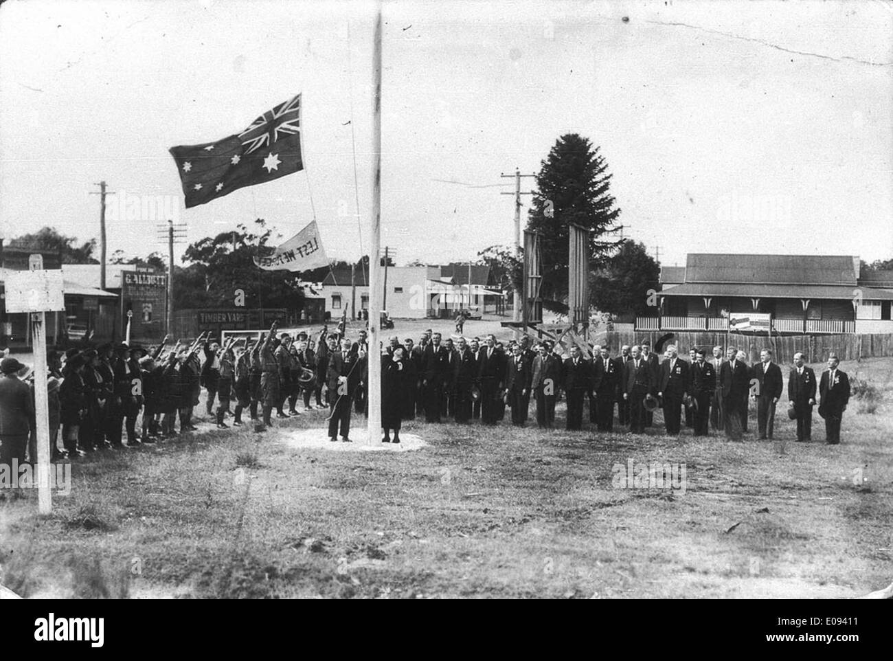 Mrs Charles Sharp unfurling the flag on Anzac Day - Coffs Harbour, NSW, 25 April 1937 Stock Photo