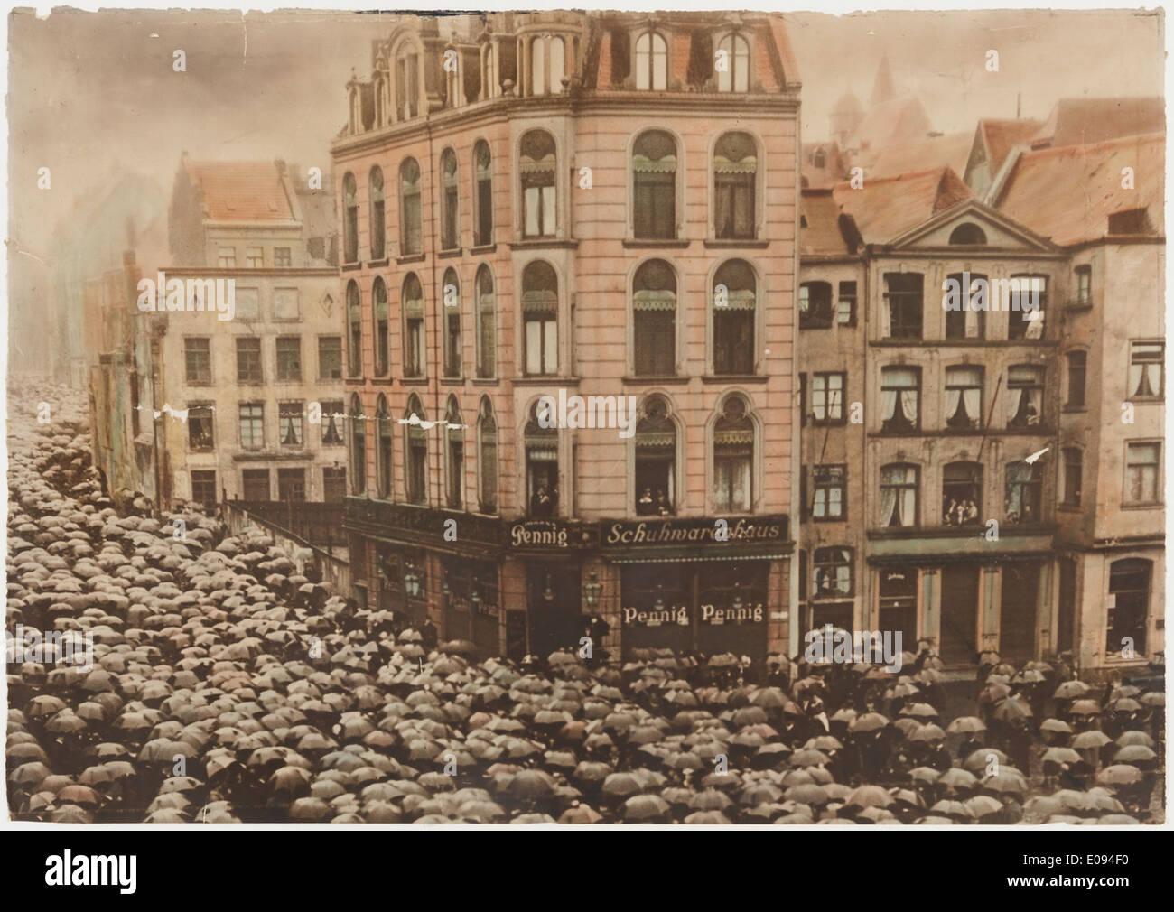 German crowd with umbrellas Stock Photo