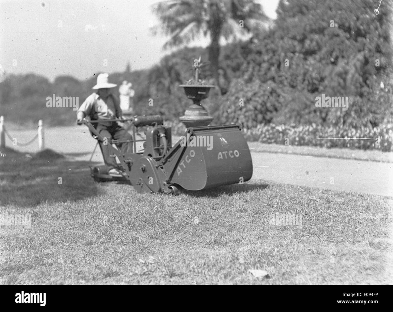 Gardener on Atco ride-on lawn mower, c. 1932, by Ted Hood Stock Photo