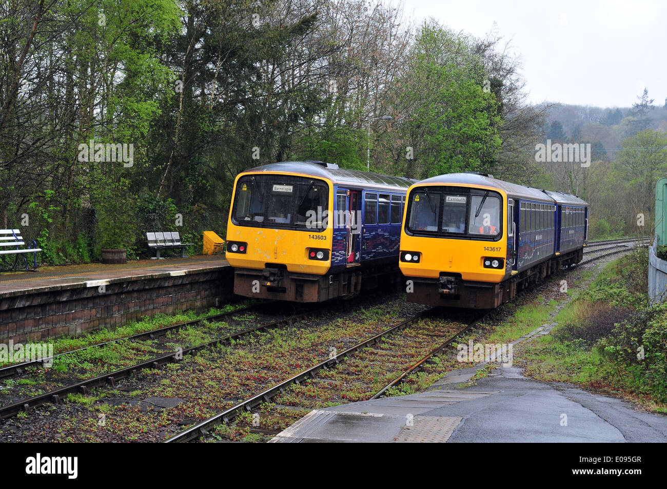 Two First Great Western Class 143 DMU trains pass each other at Eggesford station, Devon, England between Exeter and Barnstaple - Stock Image