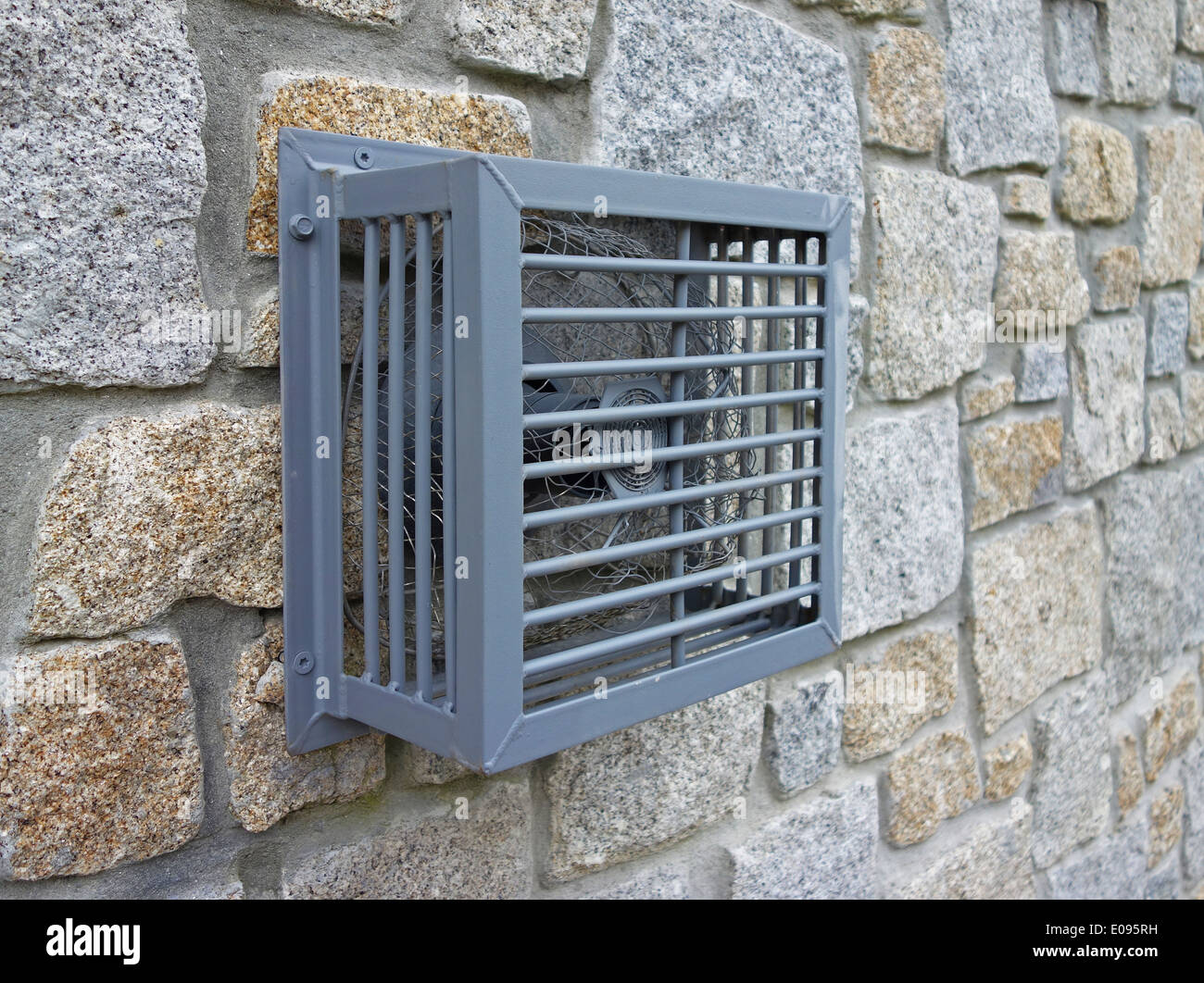 a heating ventilator on the outside of a building - Stock Image