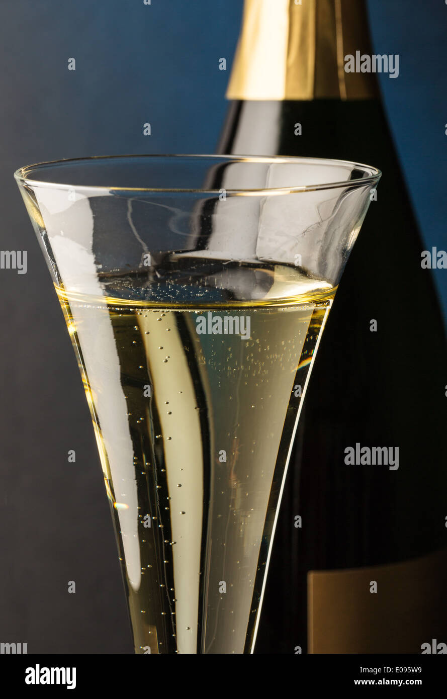 Champagne bottle with champagne glass. Symbolic photo fue celebrations and turns of the year., Champagnerflasche mit Sektglas. S - Stock Image