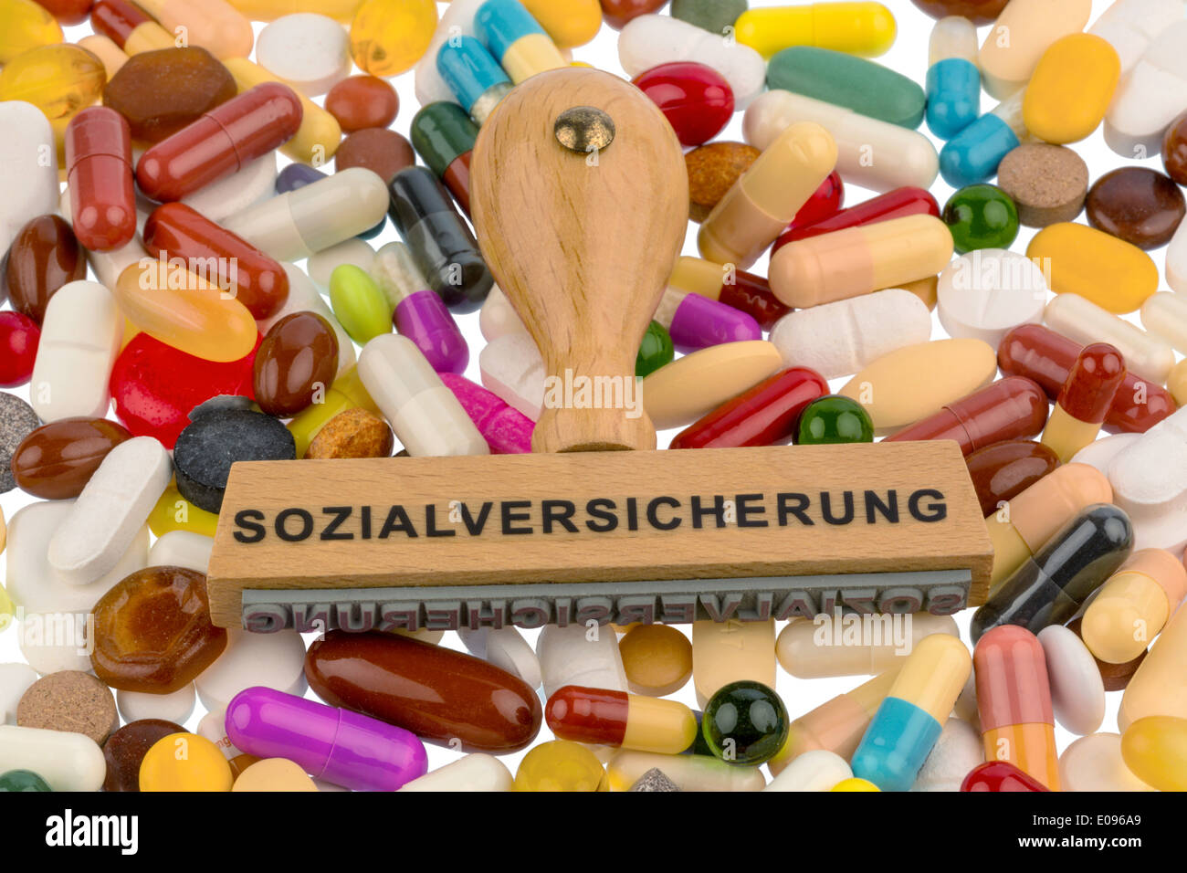 Stamp on coloured tablets, Symbolfot fue social security, drugs and cost allowance, Stempel auf bunten Tabletten, Symbolfot fue Stock Photo