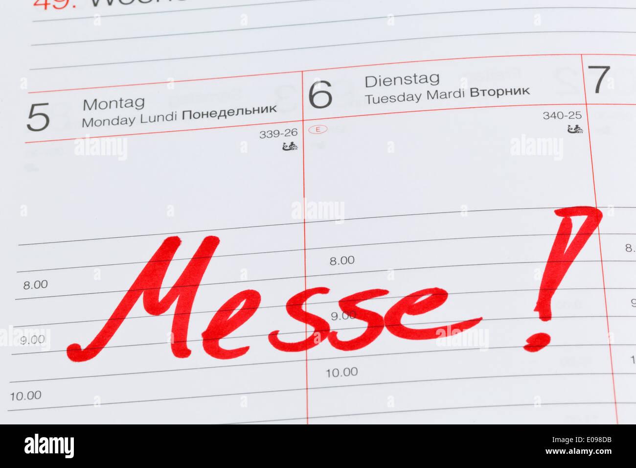 An appointment is put down in a calendar: Fair, Ein Termin ist in einem Kalender eingetragen: Messe Stock Photo