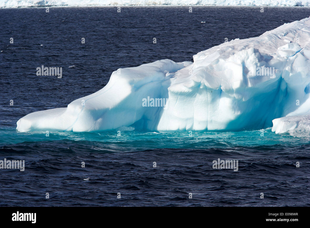 blue iceberg sculpted by wind and tide arctowski peninsula Antarctica - Stock Image