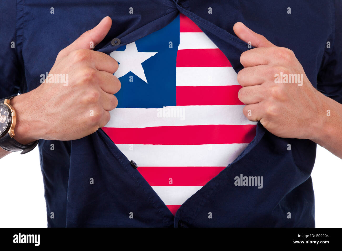 Young sport fan opening his shirt and showing the flag his country Liberia - Liberian flag - Stock Image