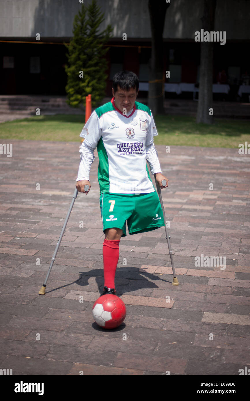 Mexico City, Mexico. 6th May, 2014. A man on crutches plays soccer during the 4th Fair of Rights of People with Stock Photo