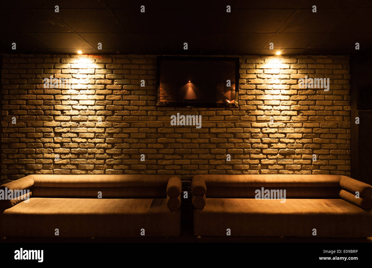 Brick wall lighting Garden Old Type Brick Wall Texture Front Face And Two Sofa With Local Lighting Alamy Old Type Brick Wall Texture Front Face And Two Sofa With Local Stock