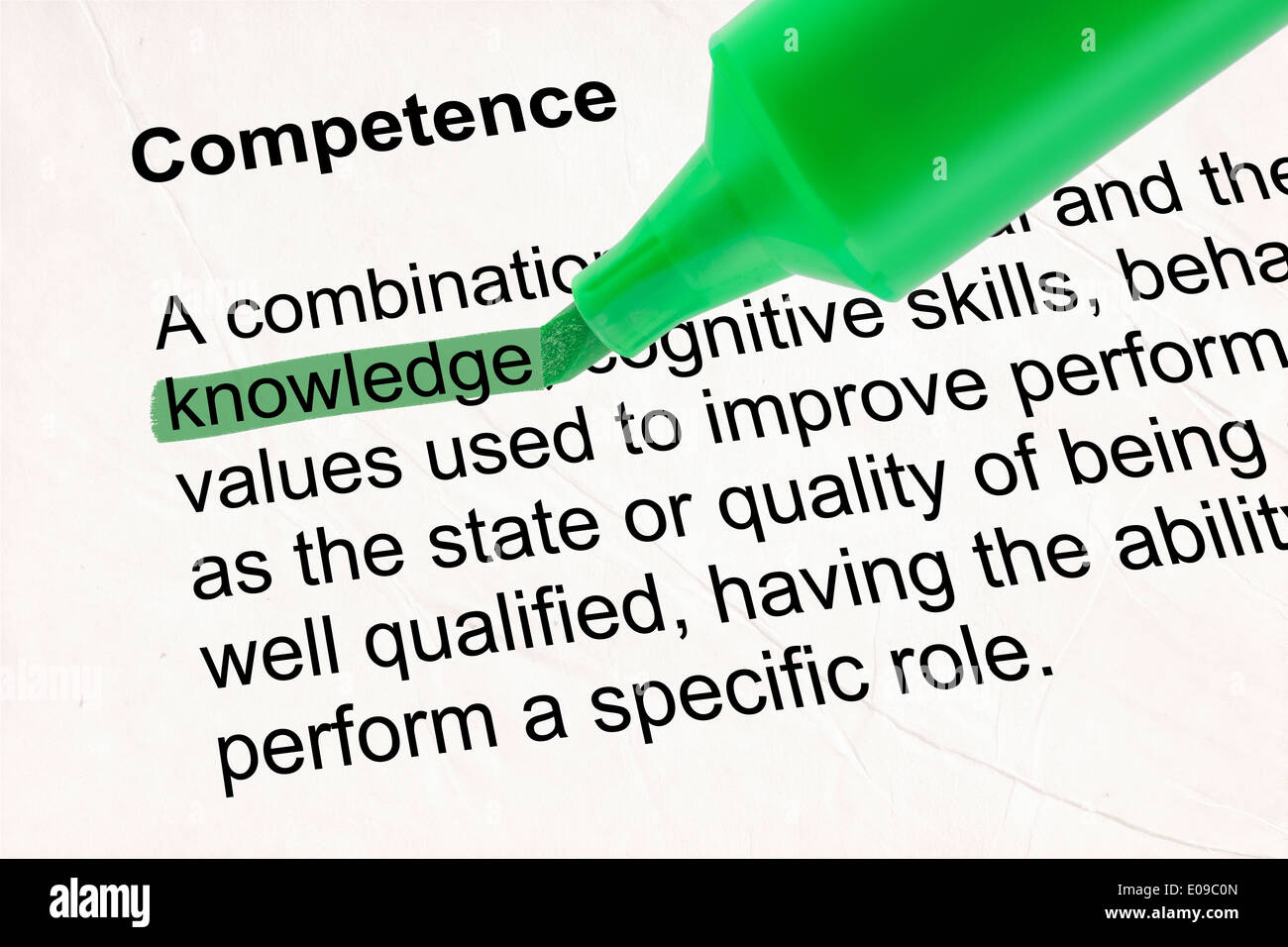 Highlighted word knowledge with green pen over textured paper - Stock Image