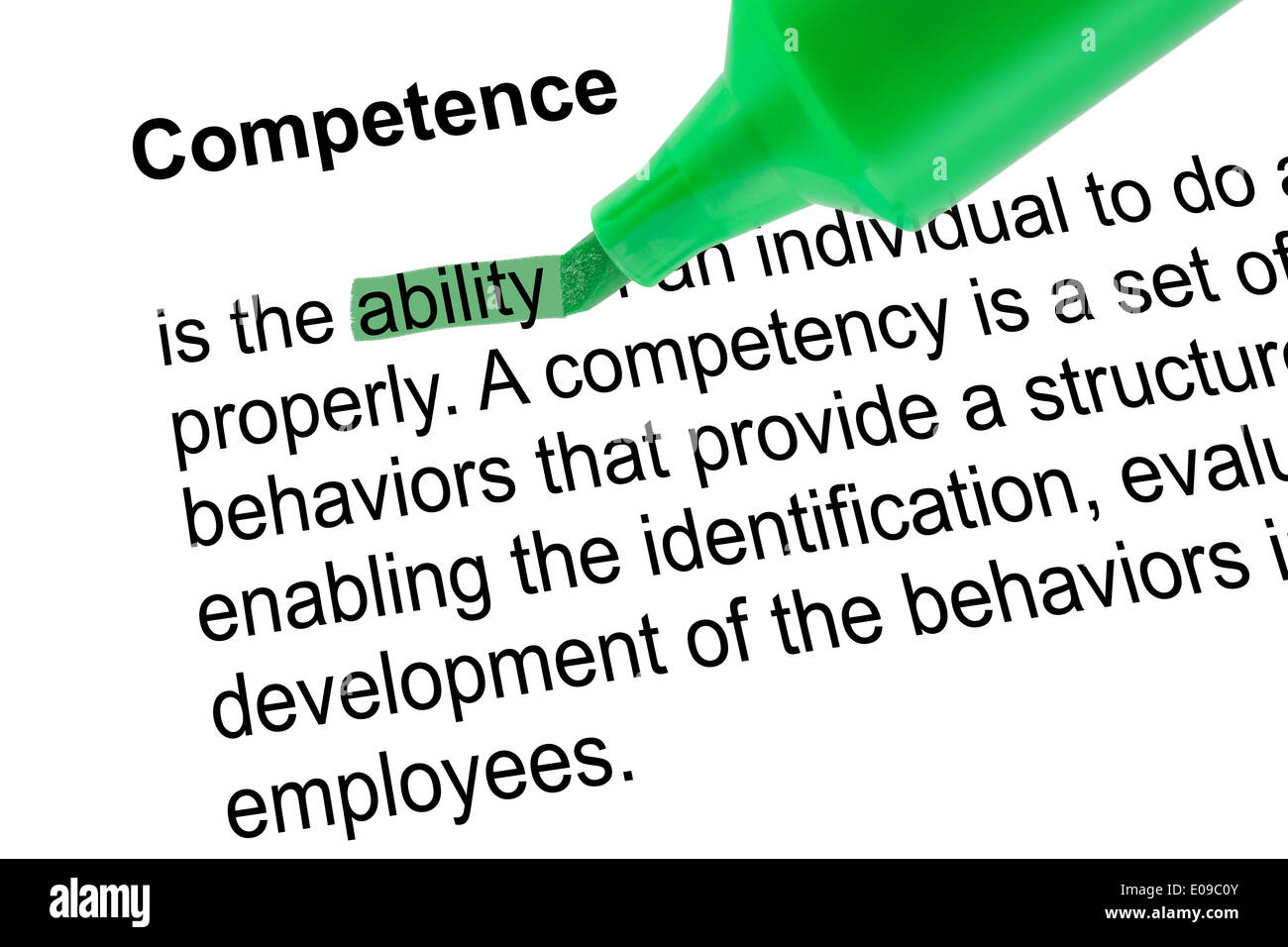 Highlighted word ability for Competence with green pen over white paper. Isolated white background. - Stock Image