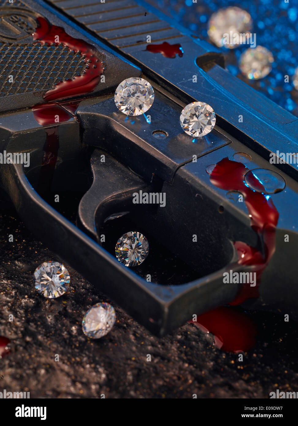 Trigger of pistol with diamonds and blood, close-up - Stock Image