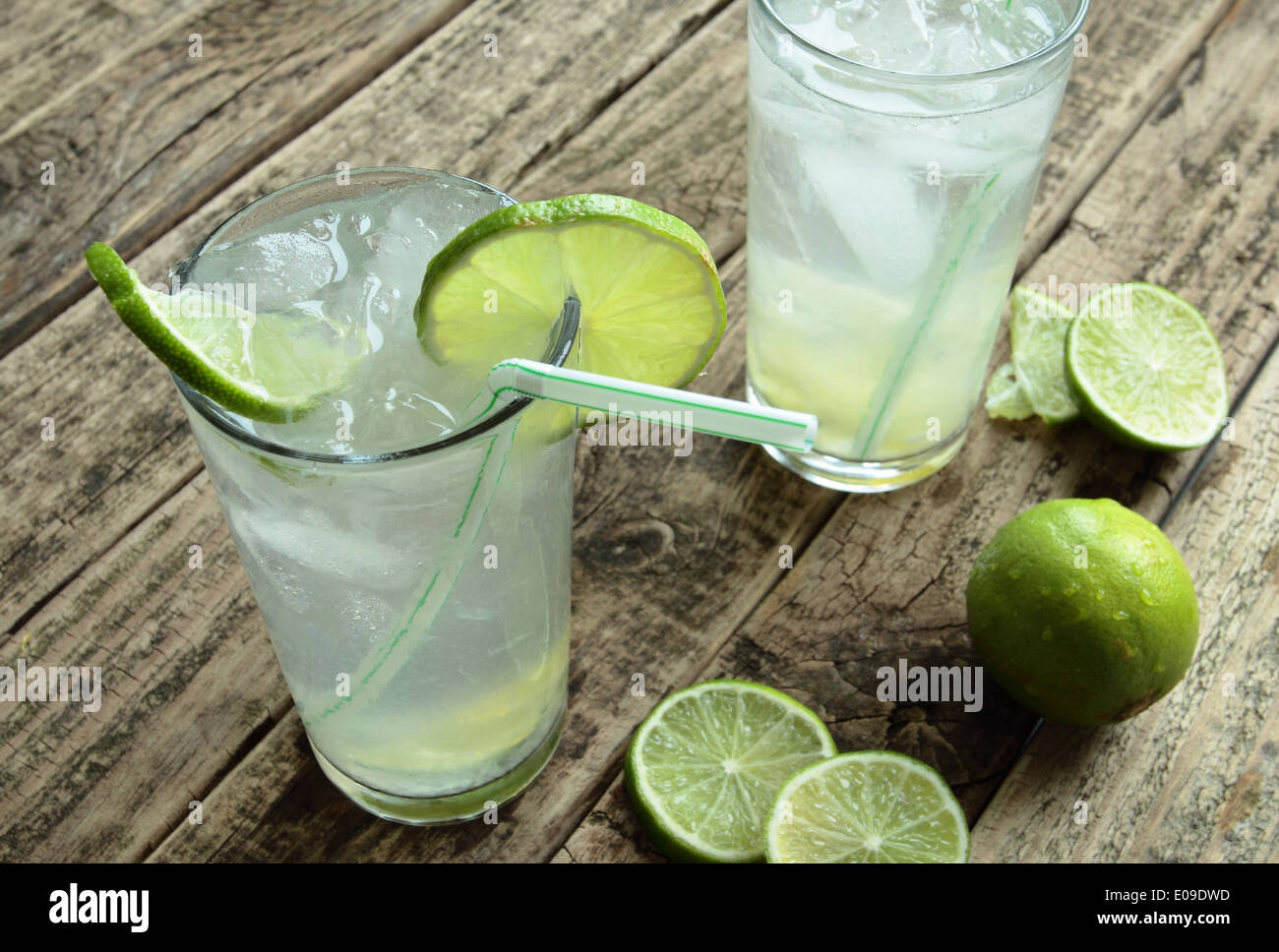 Cold drink with fresh lime and ice - Stock Image