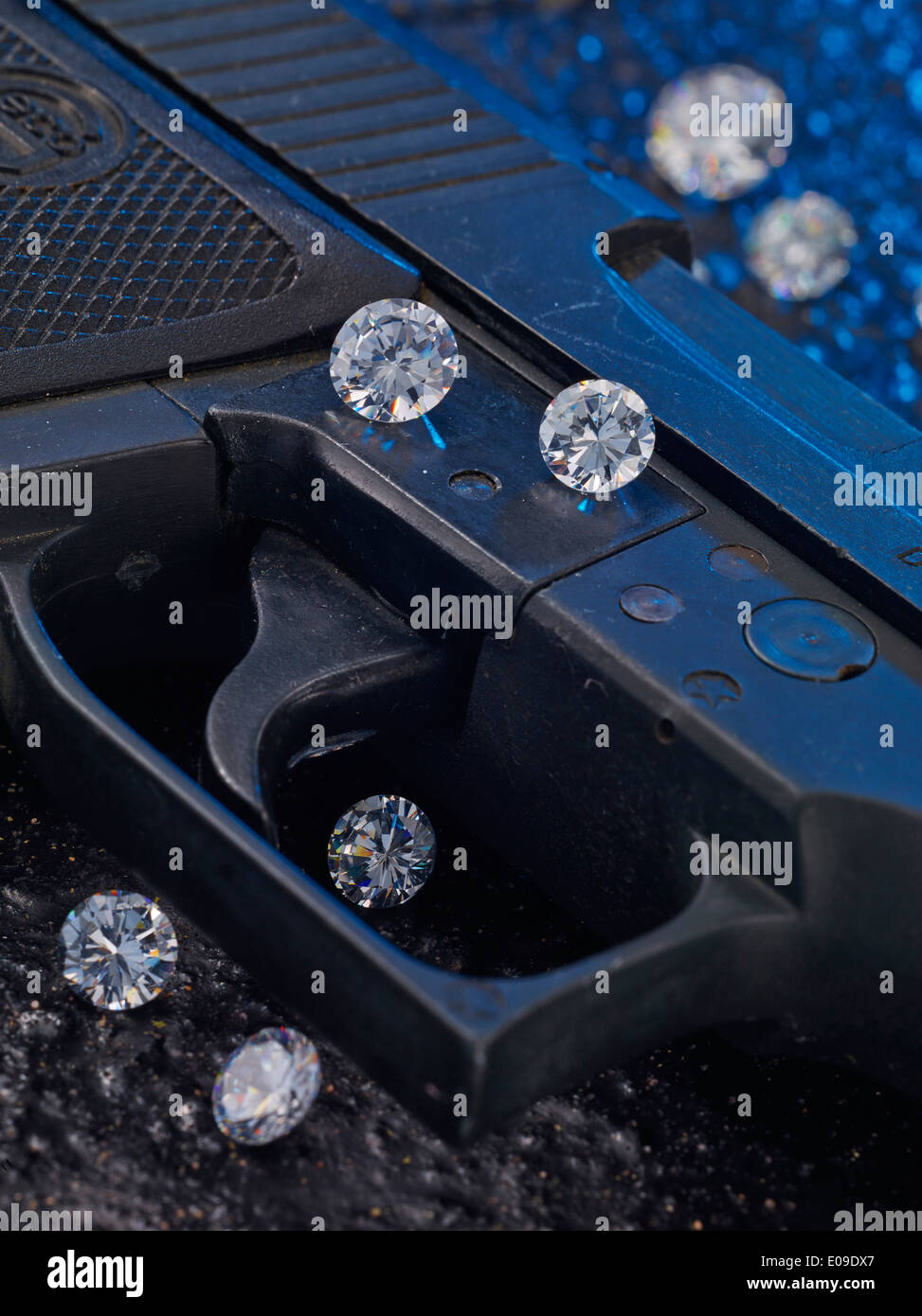 Trigger of pistol with diamonds, close-up - Stock Image