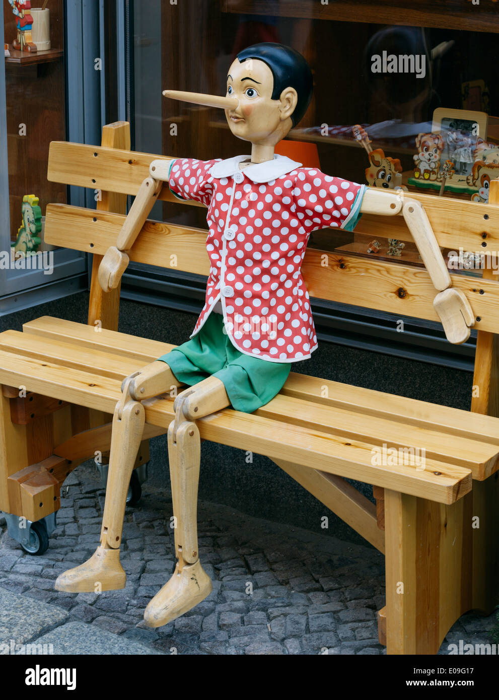Amazing Full Size Wooden Pinocchio Sitting On Wooden Bench In Front Ocoug Best Dining Table And Chair Ideas Images Ocougorg