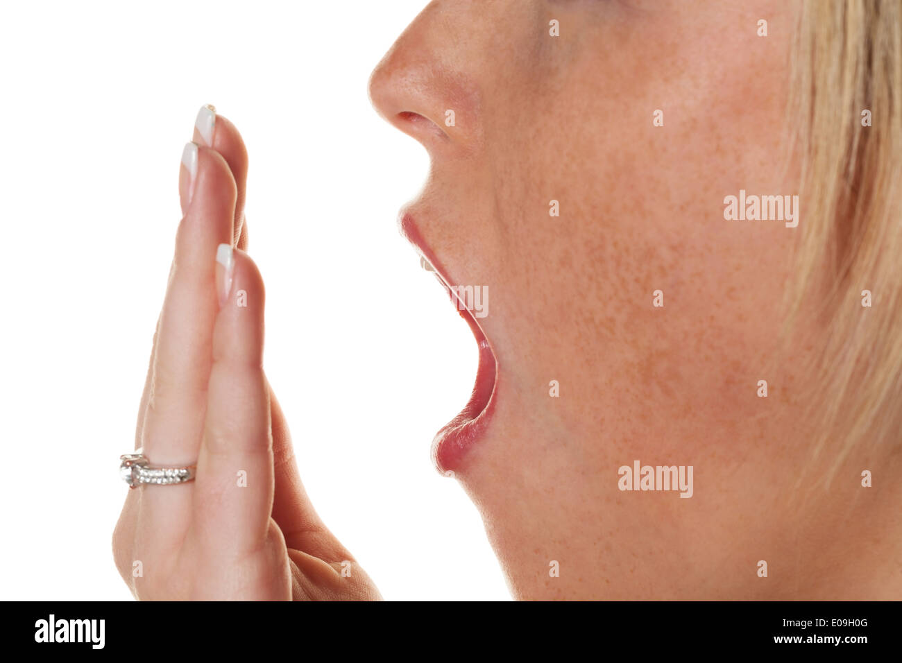 A young woman keeps the hand before the mouth with the yawn. Tiredness and sleeping lack, Eine junge Frau haelt Stock Photo