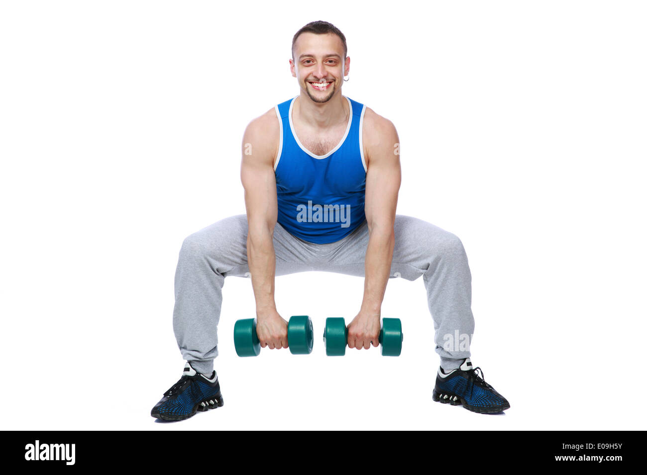 Sport man working out with dumbbells over white bakground - Stock Image