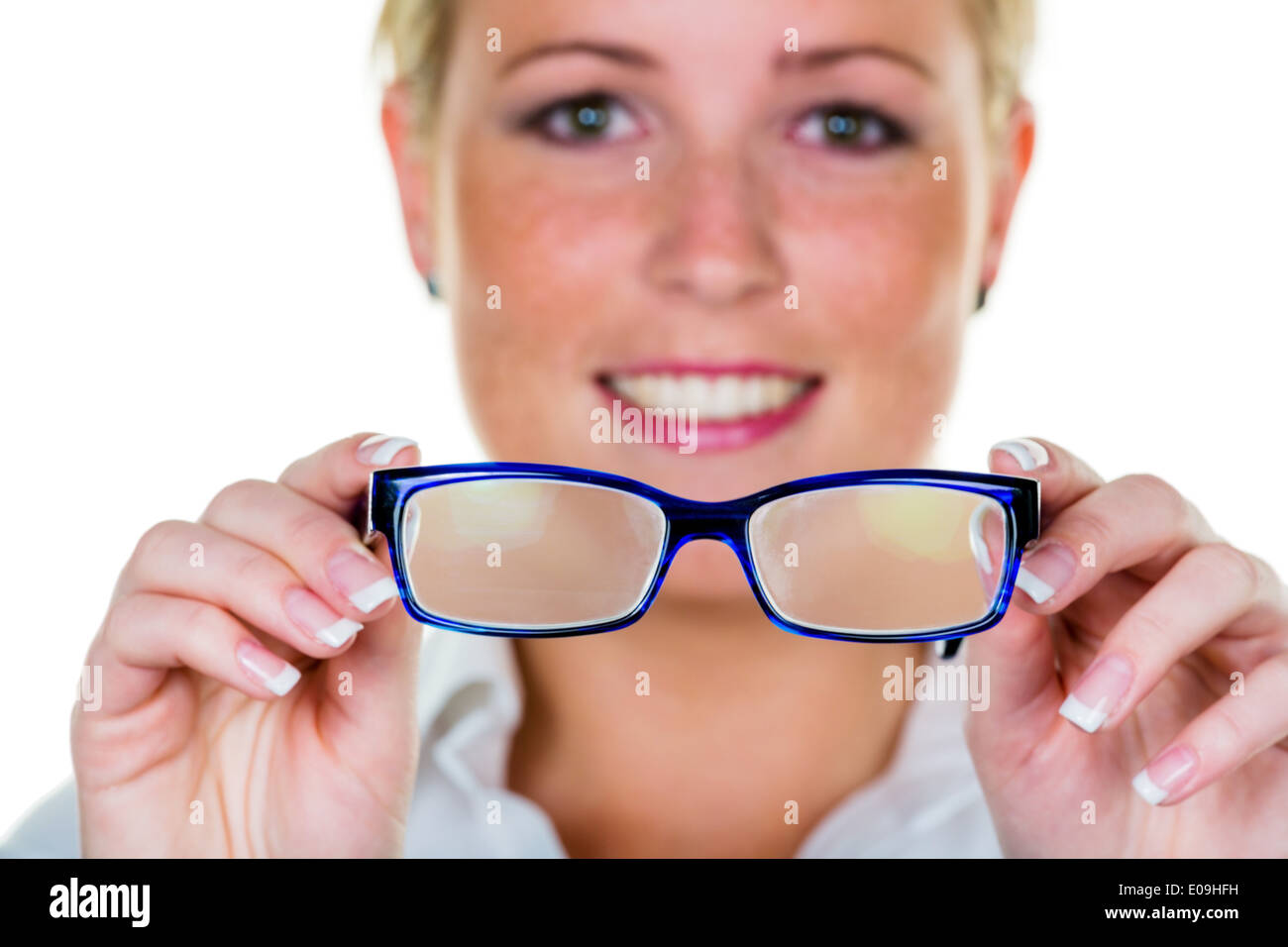 A woman holds glasses in the hand. Symbolic photo fue bad seeing and defective vision, Eine Frau haelt eine Brille in der Hand. Stock Photo