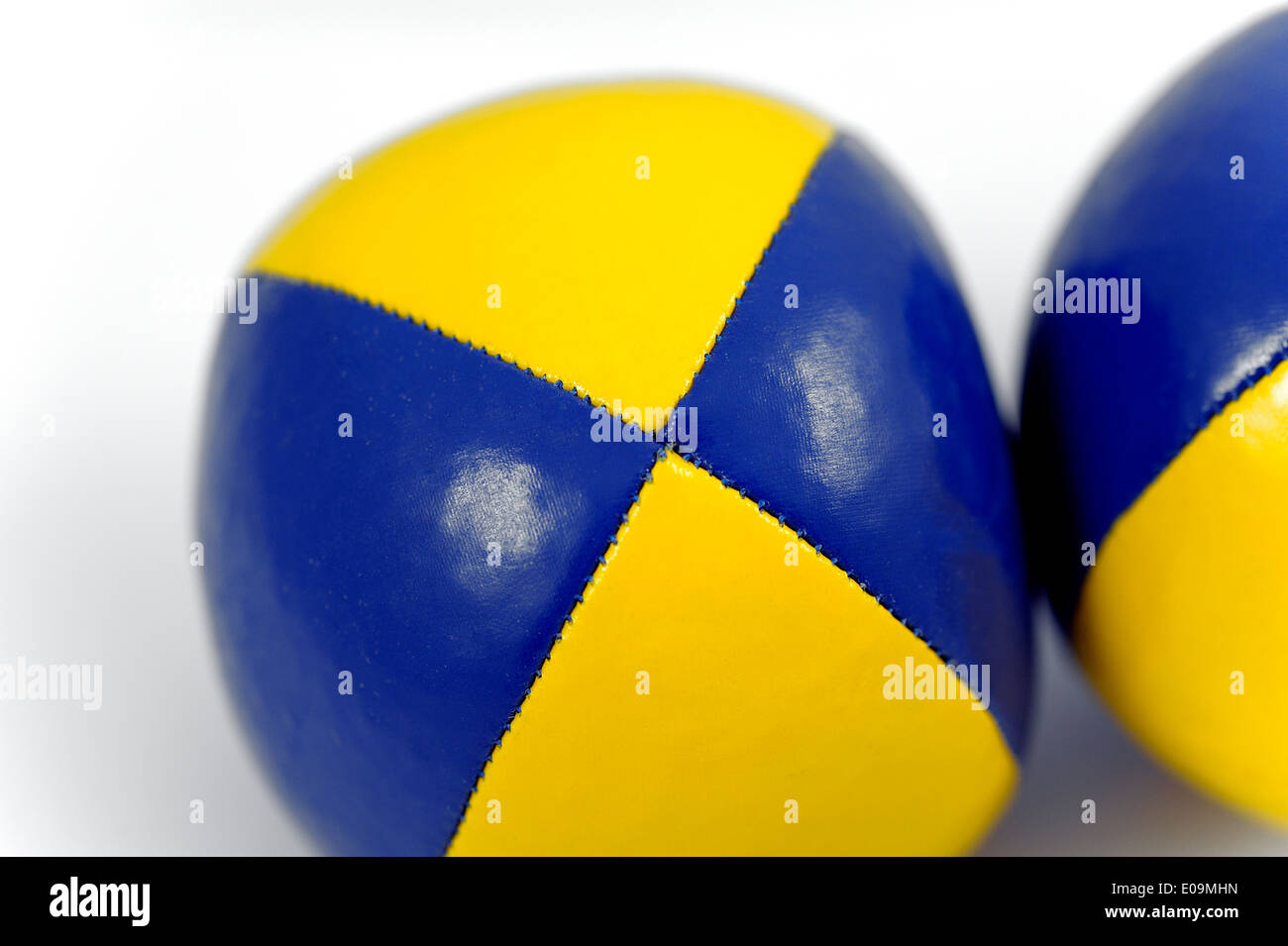 Blue and Yellow soft juggling balls - Stock Image