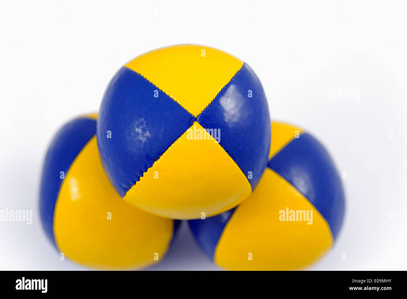 3 Blue and Yellow soft juggling balls - Stock Image