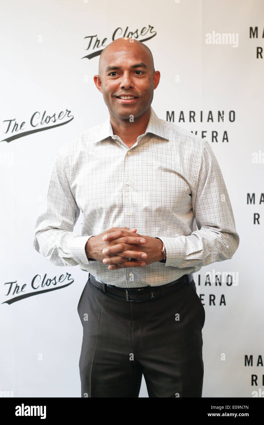 Former baseball pitcher Mariano Rivera signs copies of his book 'The Closer: My Story' at Book Revue on May 6, 2014. - Stock Image