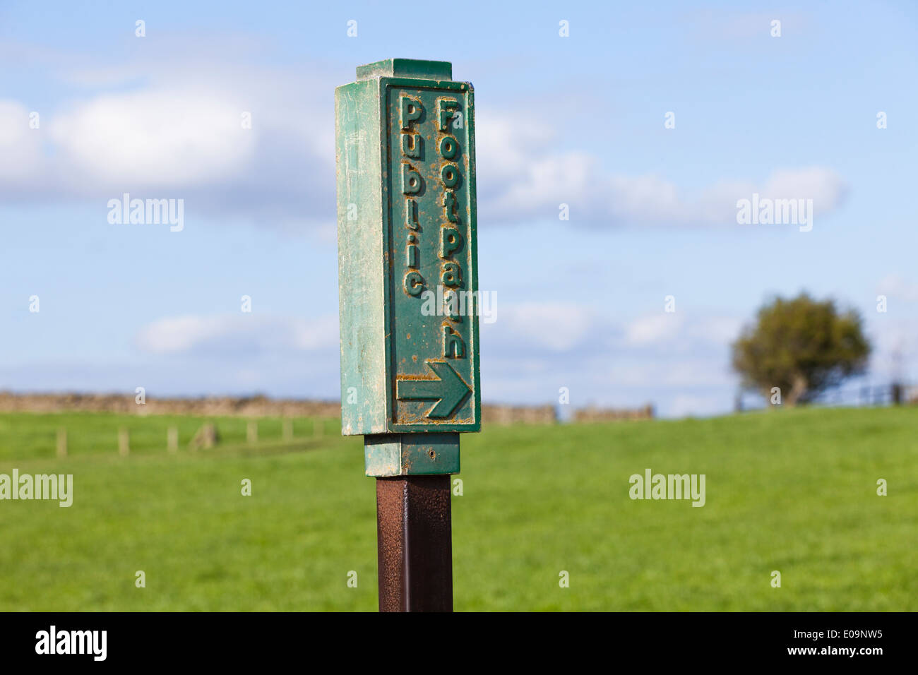 Unusual metal public footpath marker sign at North Rigton, North Yorkshire UK - Stock Image
