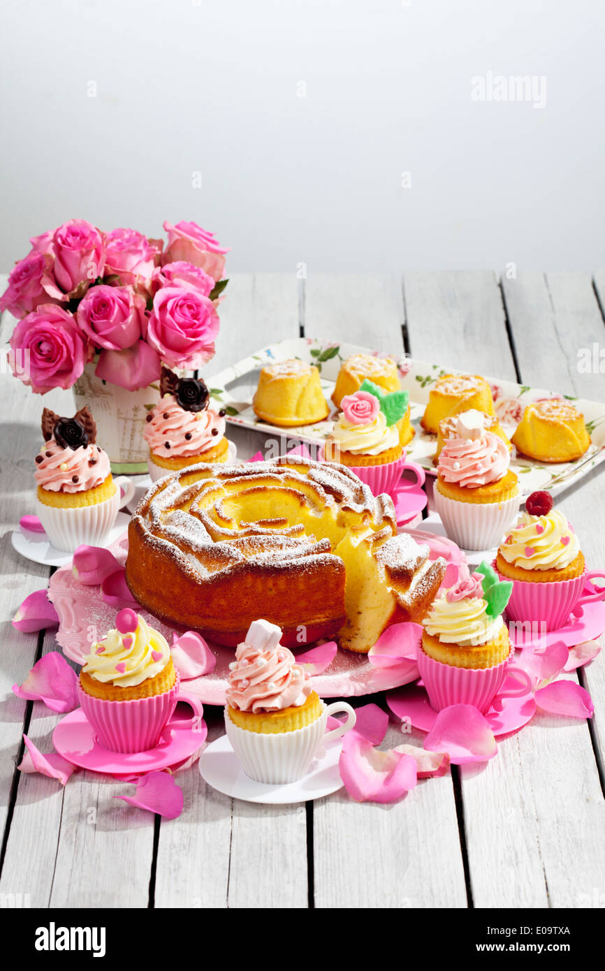 Birthday Cake Cupcakes Muffins And Flower Vase Of Pink Roses On