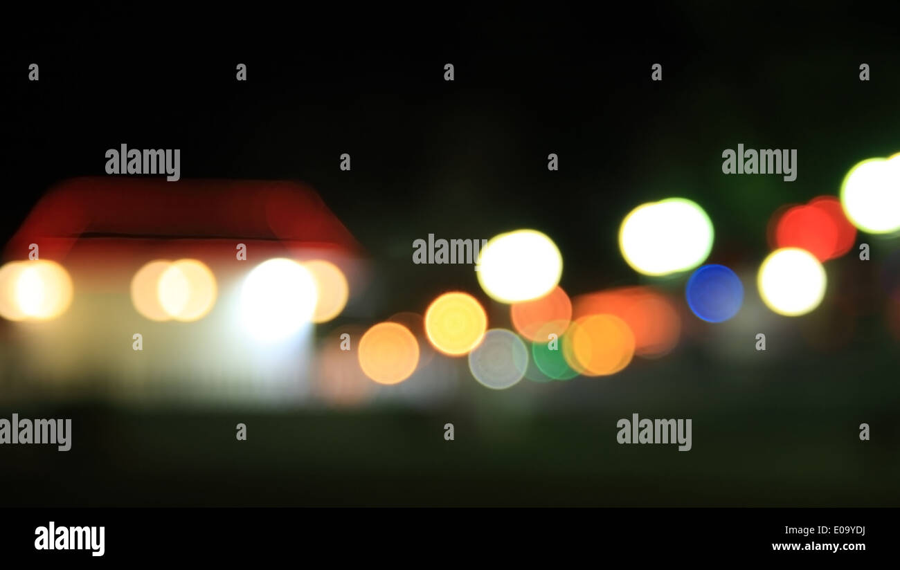 Holidays Lights in suburb. Blurry pattern of colorful decoration lights. - Stock Image