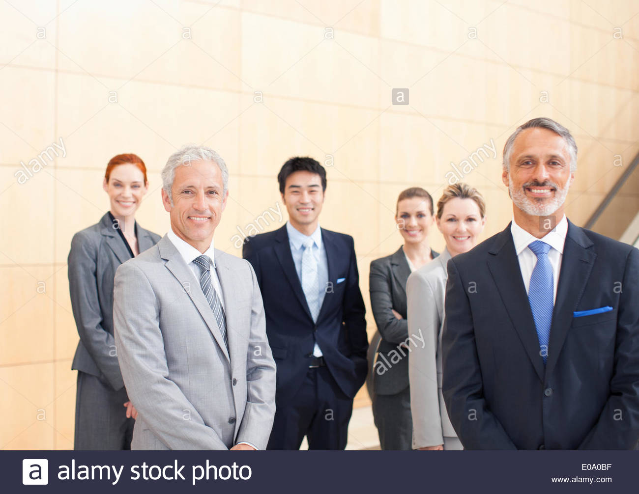 Business people smiling - Stock Image
