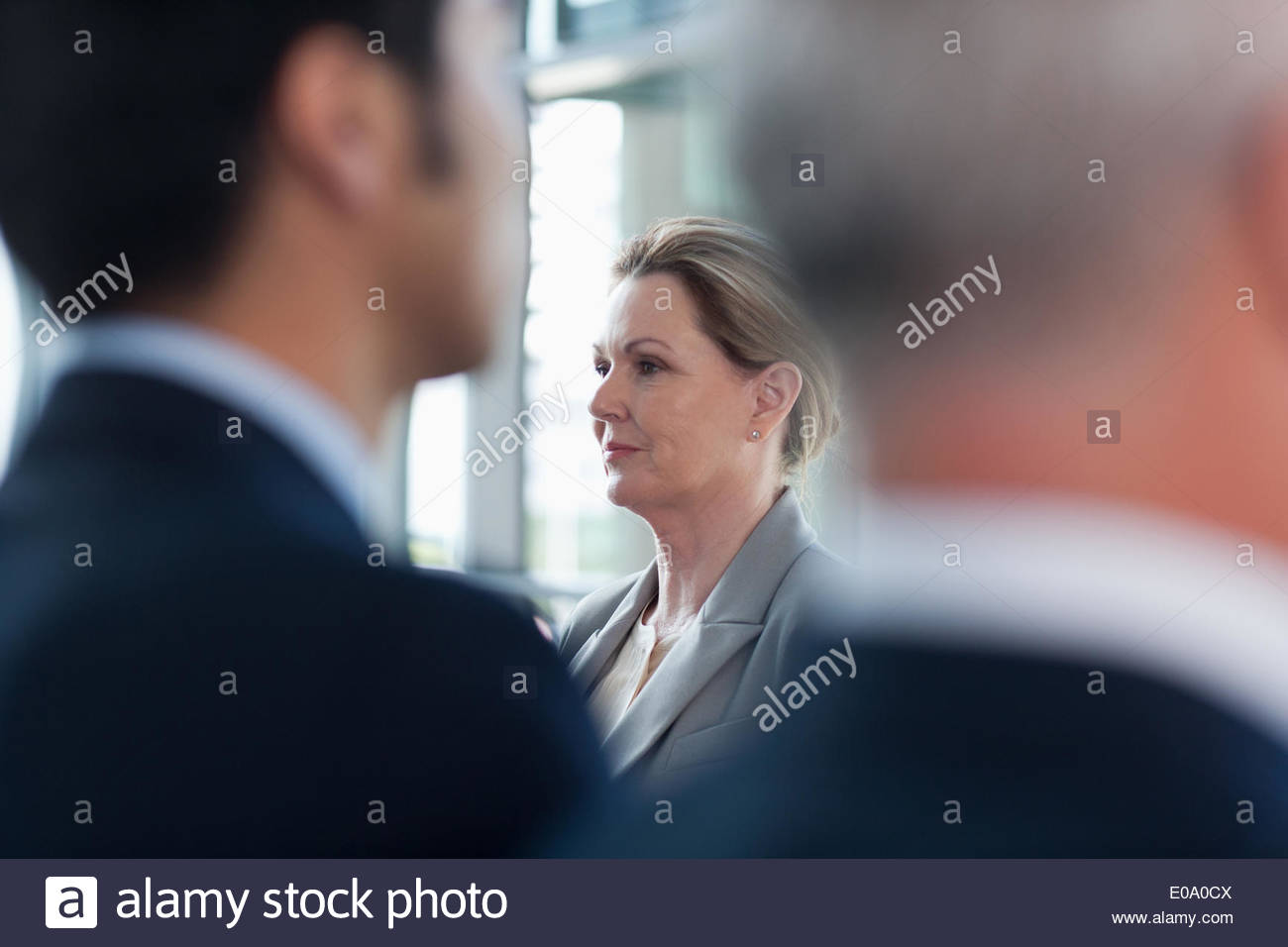 Business people talking face to face - Stock Image