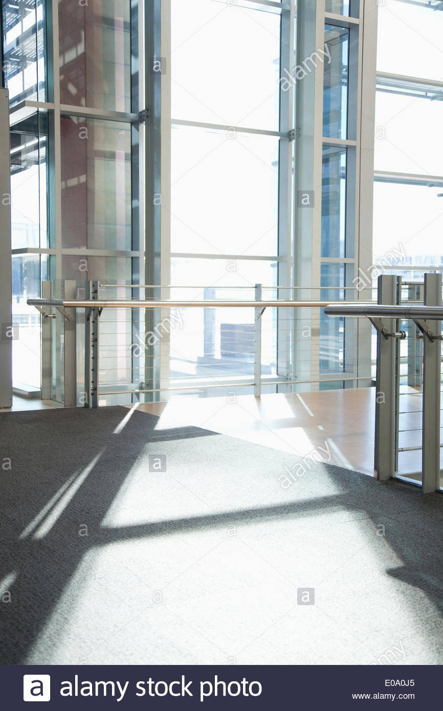 Windows in lobby of office building - Stock Image