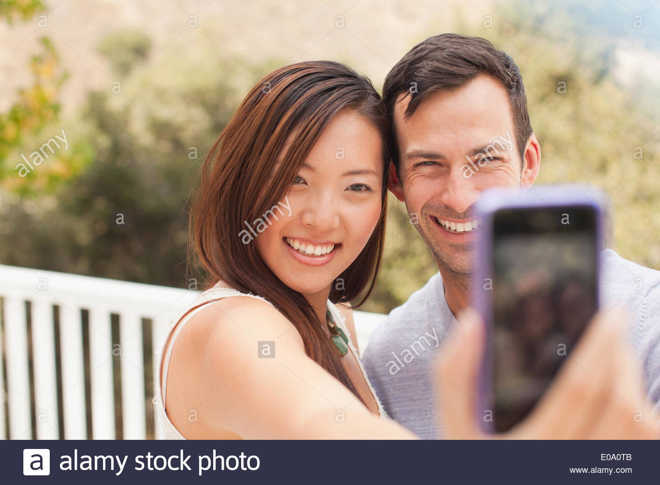 Couple taking picture of themselves - Stock Image
