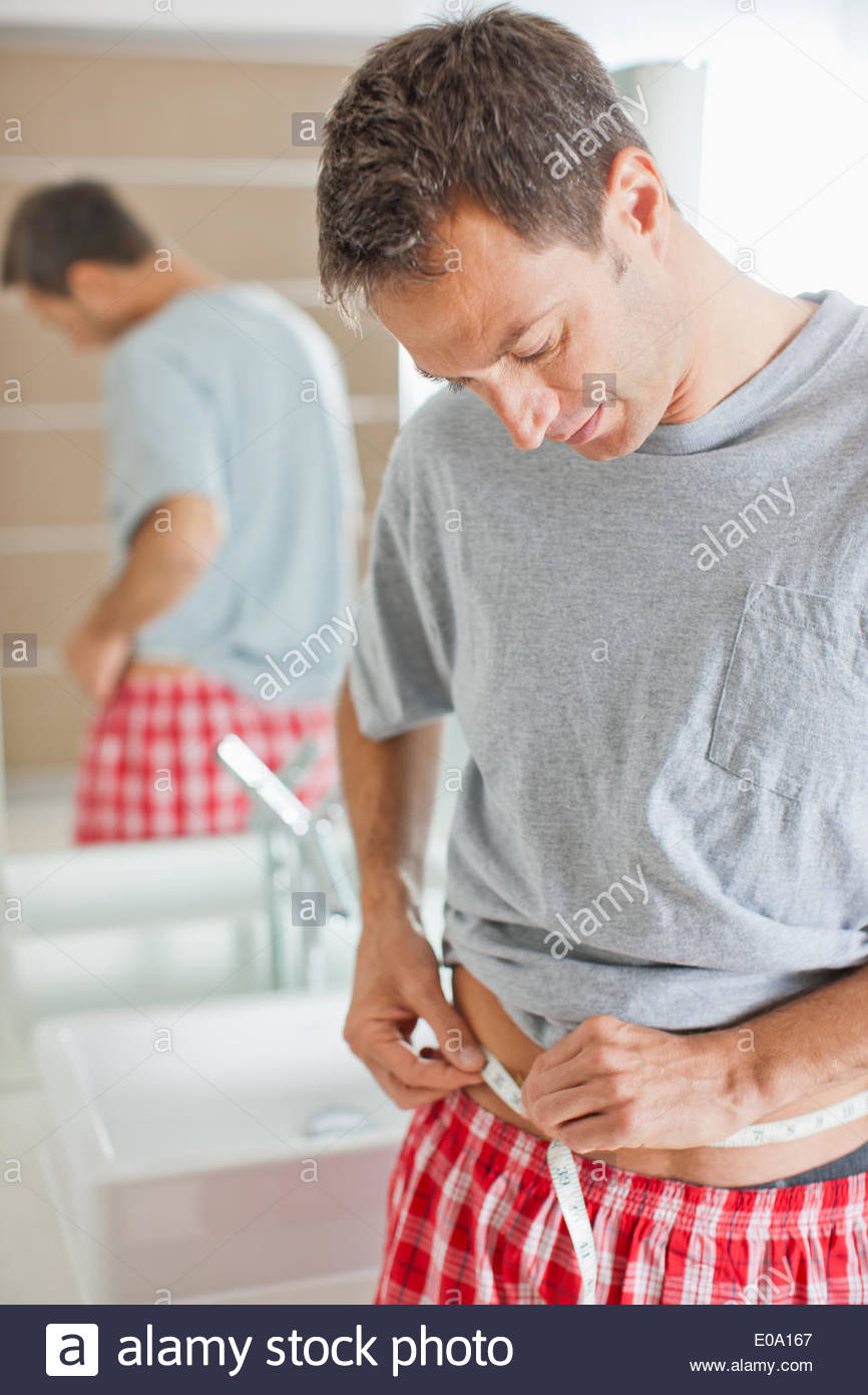Man measuring waistline - Stock Image