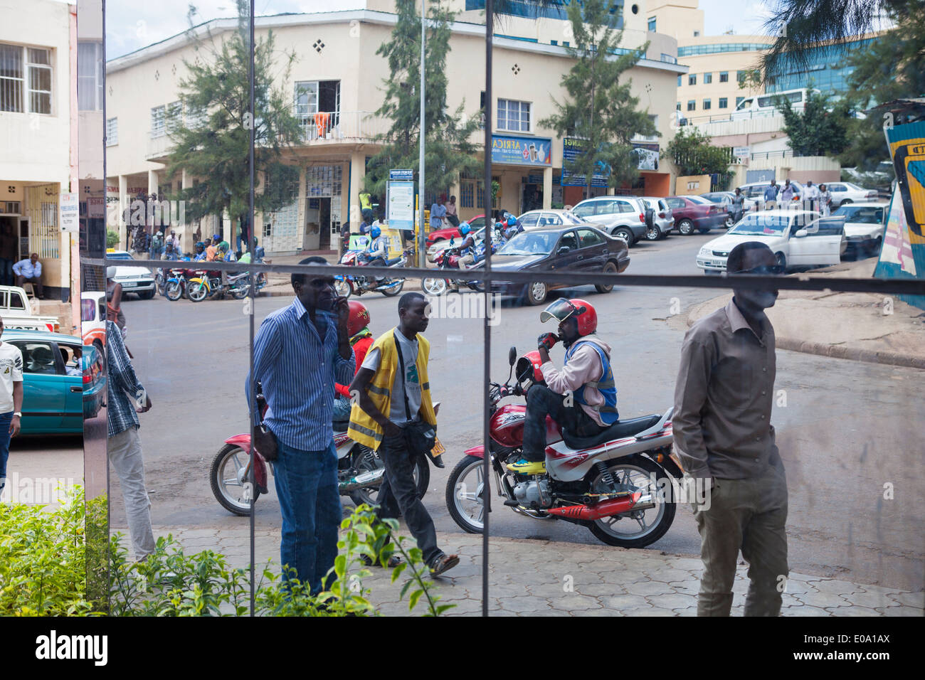 Street scene in downtown Kigali reflected on modern building, Rwanda. - Stock Image