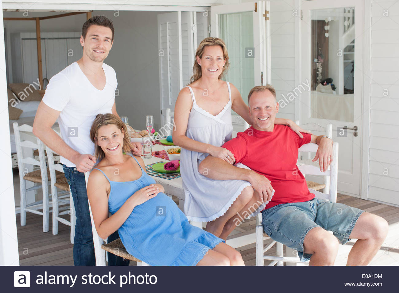 Pregnant couple and friends having breakfast - Stock Image