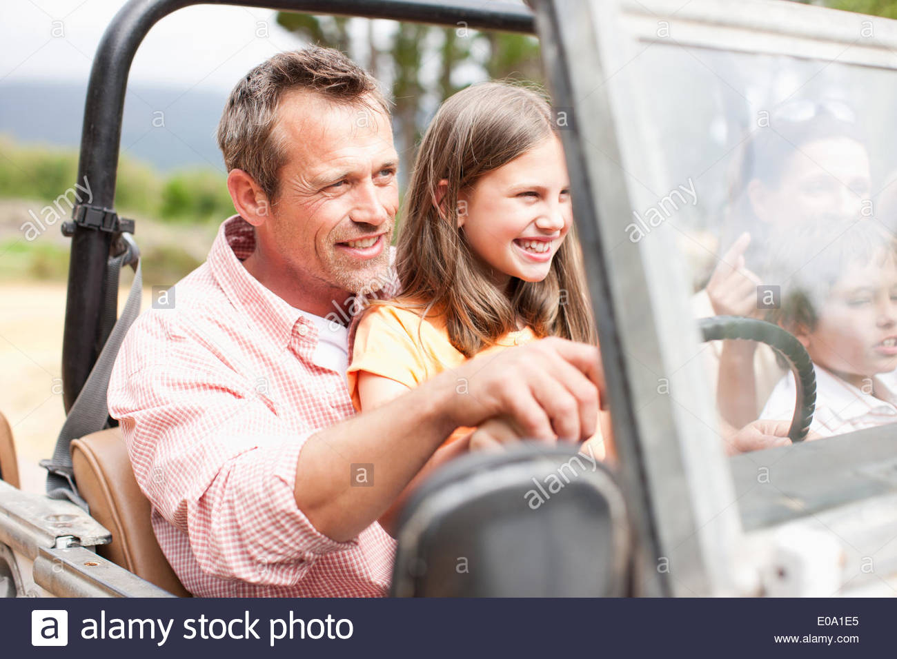 Family riding in vehicle - Stock Image